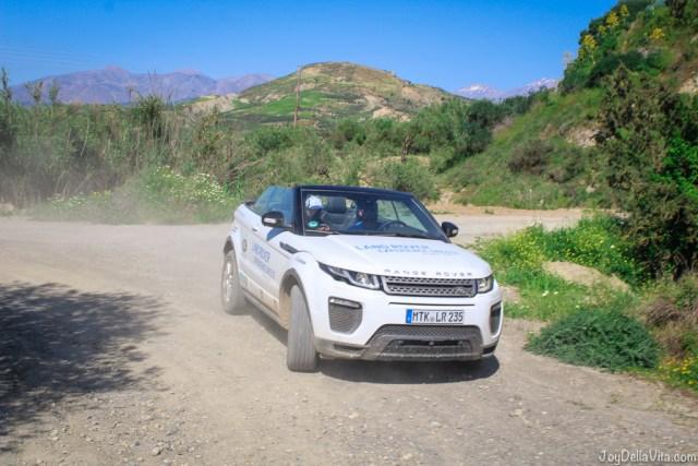 white suv offroad range rover evoque convertible crete summer sun