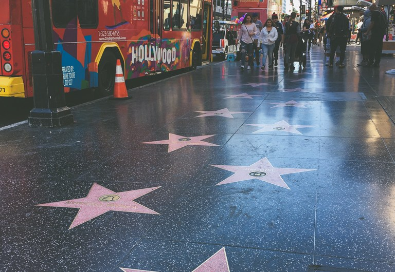 Walking along Walk of Fame on Hollywood Boulevard Los Angeles