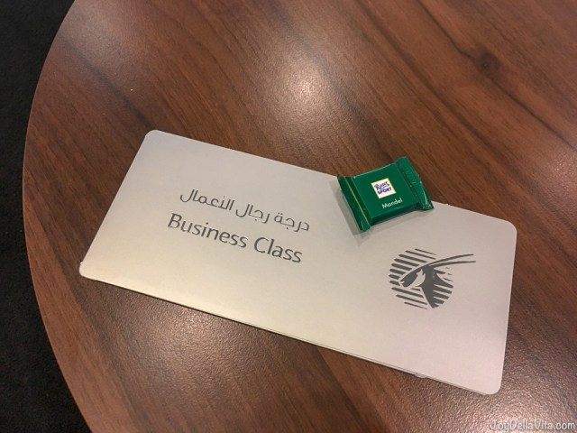 exclusive paper wallet for my Qatar Airways Business Class Boarding Ticket - and a small chocolate