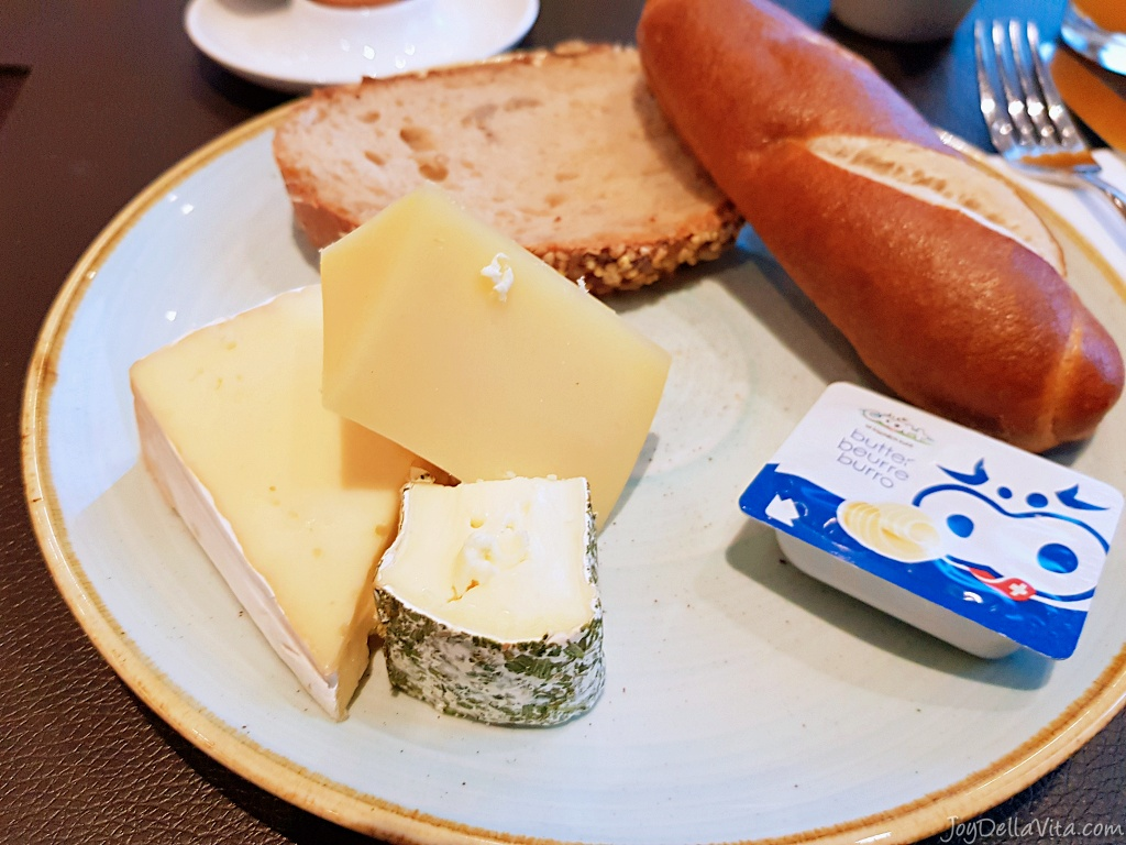 Breakfast at b smart hotel with a selection of local cheese