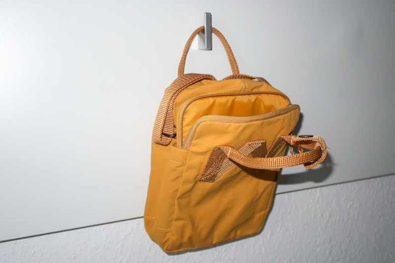 the backside of the fjallraven kanken sling with the small handles