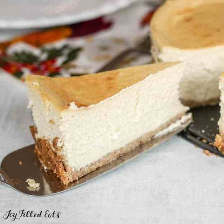 close up of a pie server lifting a slice of the vanilla ricotta cheesecake