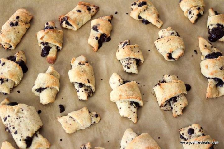 Dark Chocolate Filled Crescent Cookies on parchment
