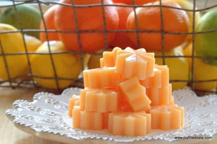 orange gummies from the easy gummies recipe stacked up on a plate