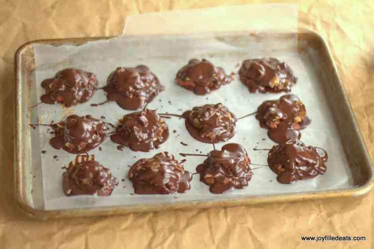 Toasted Coconut Toffee Pecan Turtles Candy topped with melted chocolate