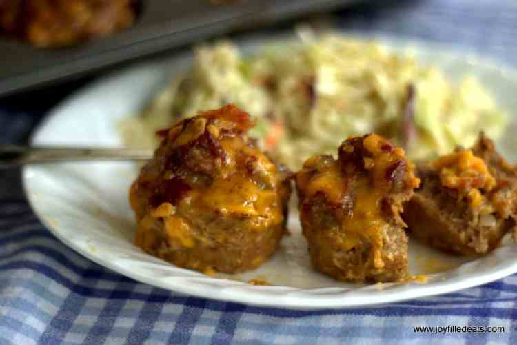 BBQ Bacon Mini Meatloaves with coleslaw on a white plate.
