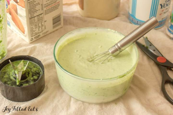 Creamy Chive Dip in a bowl with a whisk