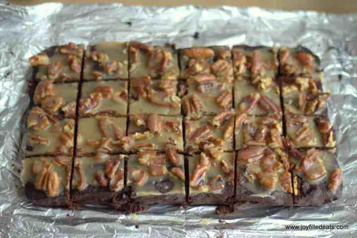 Pecan Praline Keto Brownies cut into squares on foil