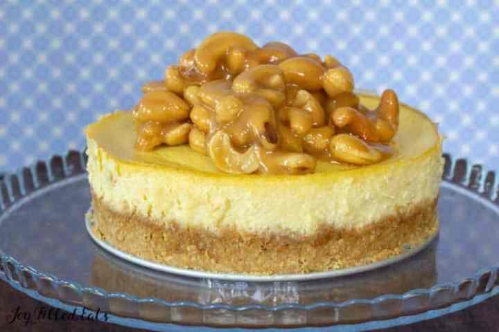 salted caramel cashew cheesecake on a glass platter