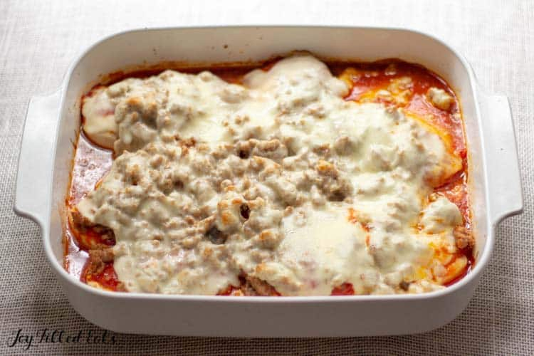 large white casserole dish of Italian Baked Chicken with Sausage