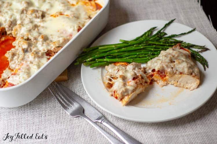 casserole dish and plate of italian sausage baked chicken