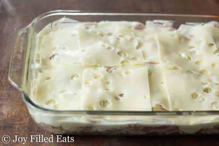 swiss cheese slices on top of the chicken casserole