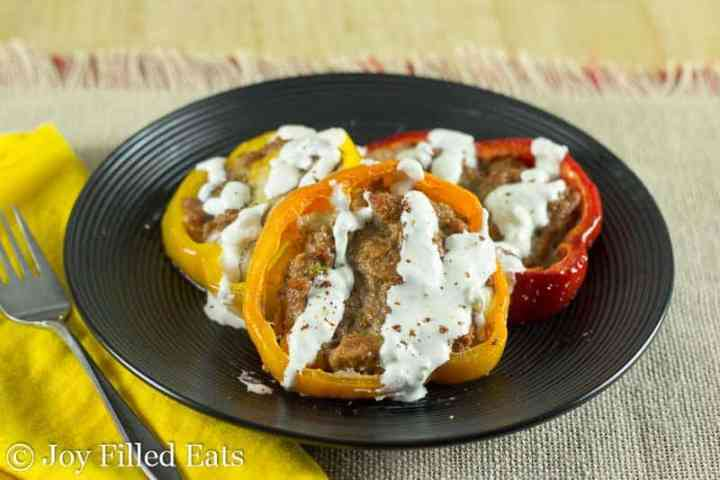 Taco Stuffed Peppers in pepper Rings on a black plate