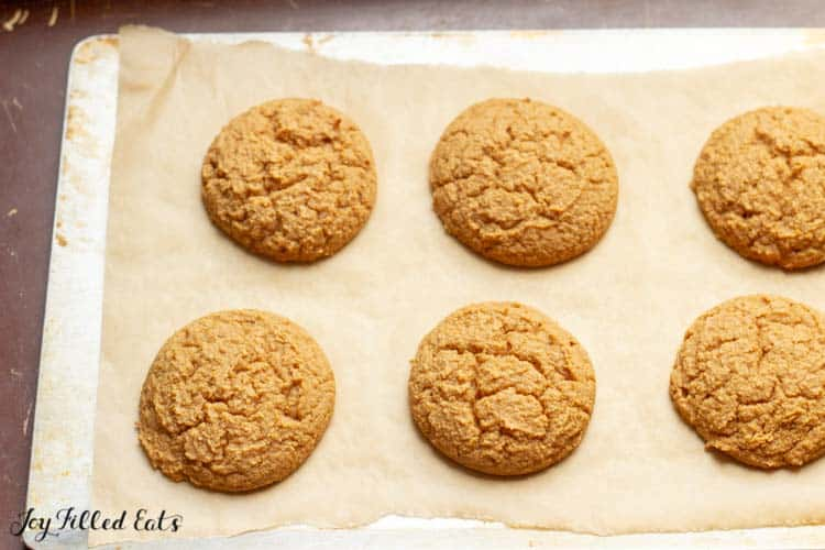 baked whoopie pie cookies on a parchment lined baking sheet