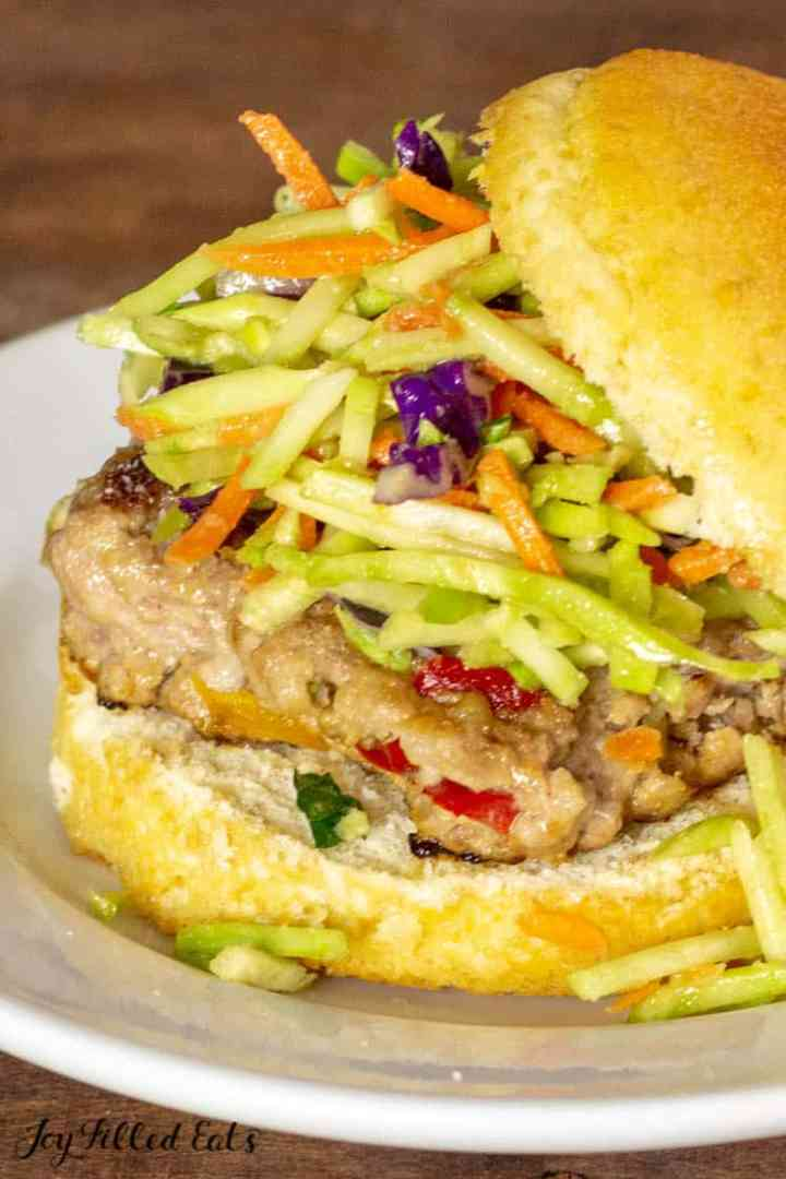 close up of an asian burger with broccoli slaw