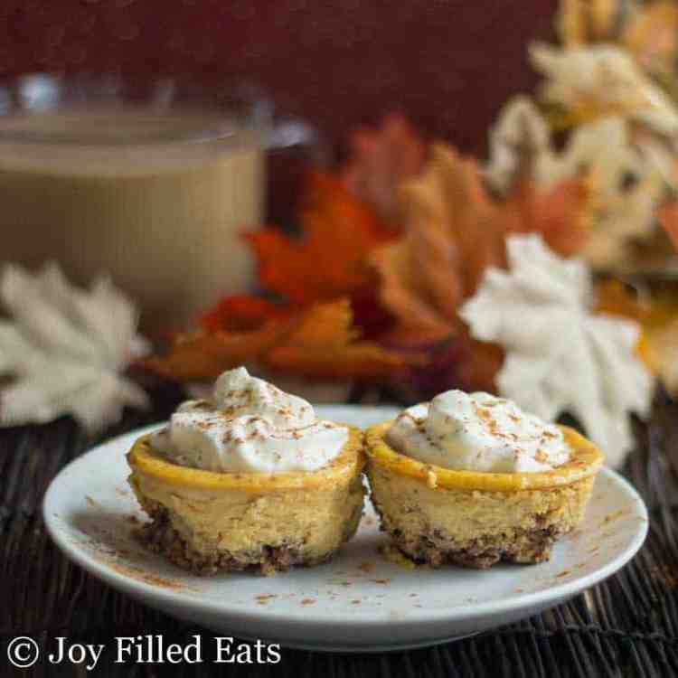2 of the mini Keto Pumpkin Cheesecake with Pecan Crust on a white plate