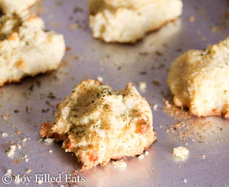 Close up of one of the Almond Flour Biscuits on a metal cooking sheet
