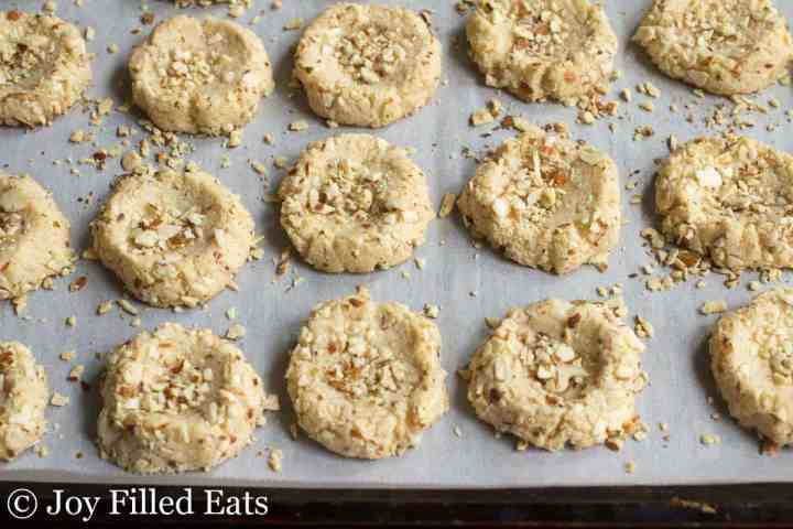 Baked Thumbprint Cookies on a cookie sheet