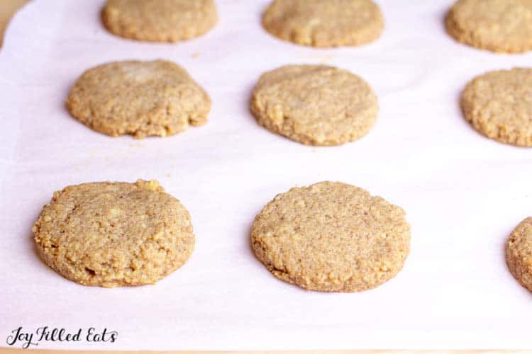 baked maple walnut cookies on parchment paper