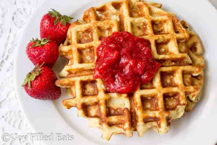 Vanilla waffles with almond flour topped with strawberry sauce