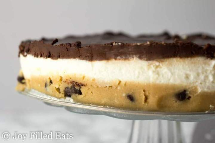 Close up on the no bake cookie dough cheesecake showing the different layers