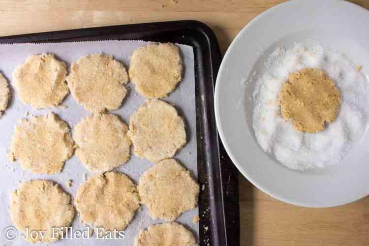 peanut cookies being dipped in sweetener