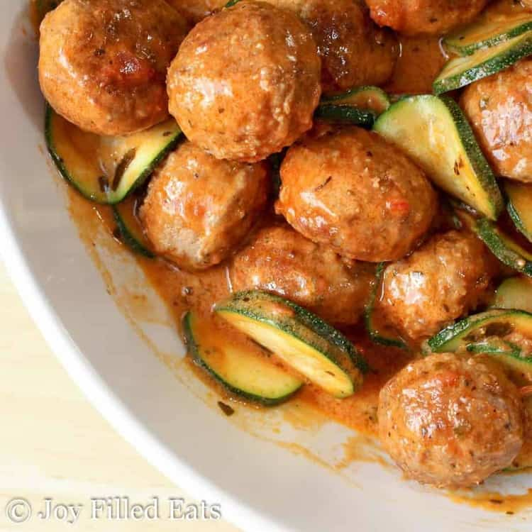 A large white bowl of Easy Meatballs with Zucchini & Mascarpone