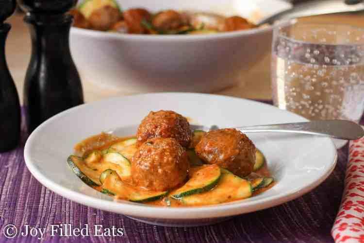 Easy Meatballs with Zucchini & Mascarpone in a white bowl