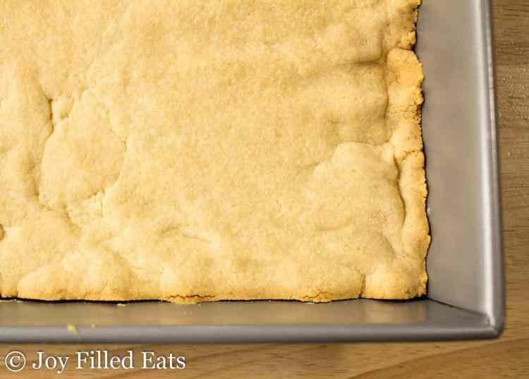 The shortbread base baked in a square pan