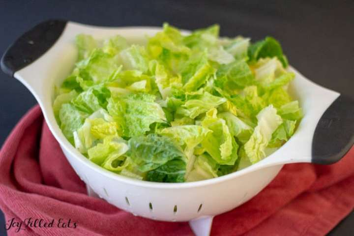 a colander with romaine lettuce