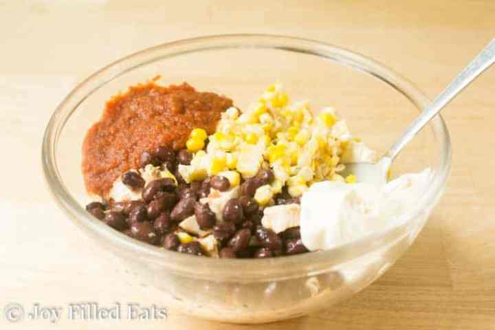 ingredients for the southwest chicken salad in a glass bowl