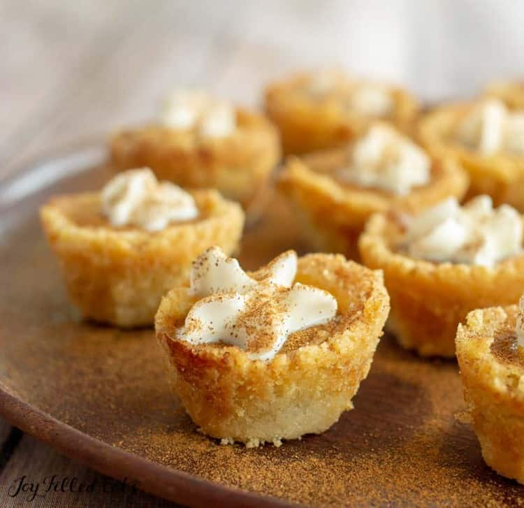close up of mini pumpkin pies sprinkled with cinnamon