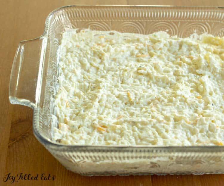 hasbrown casserole spread in a glass baking dish