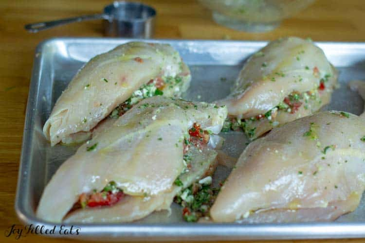 raw chicken breasts stuffed and drizzled with oil
