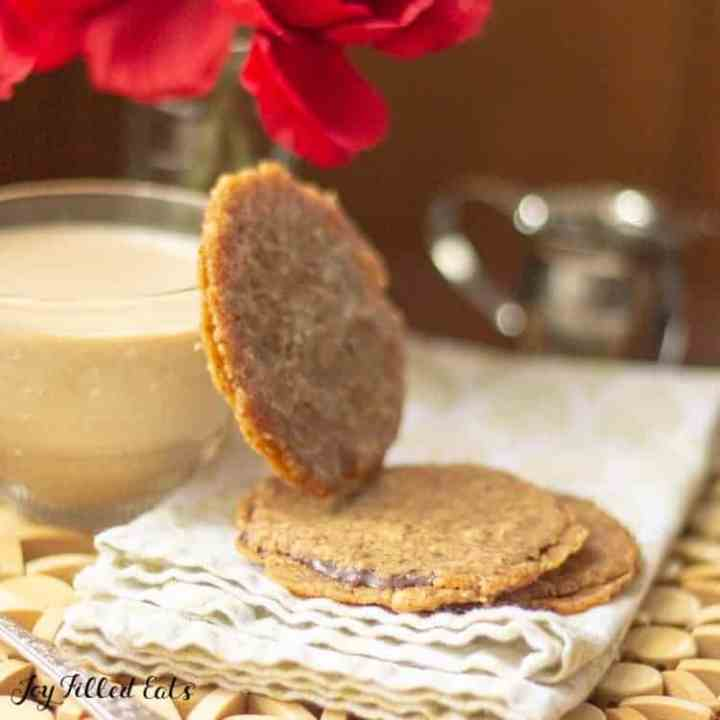 a florentine cookie leaning on a coffee cup