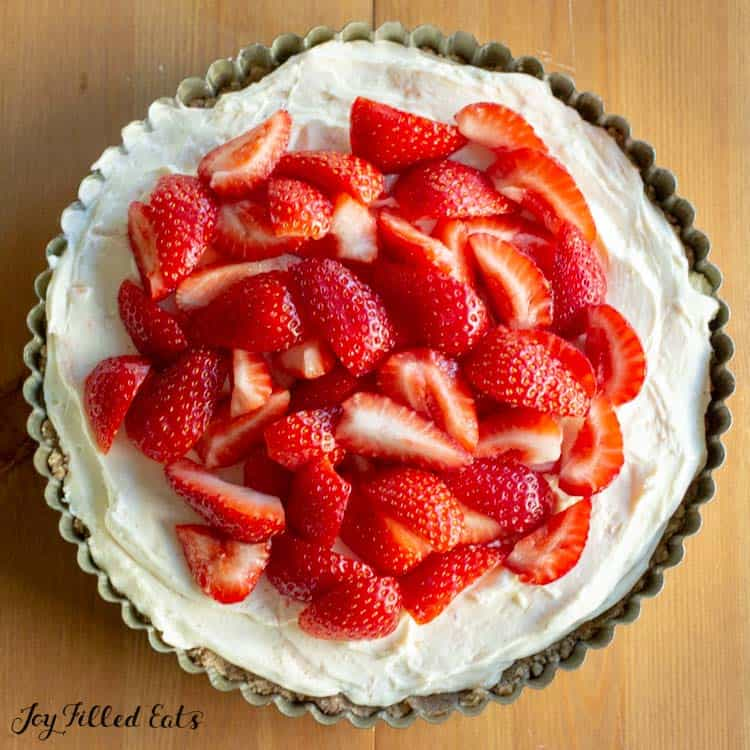 overhead shot of the strawberry tart piled with strawberries