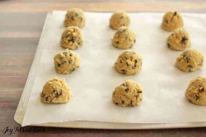 dough for the eggless cookies on a parchment paper lined cookie sheet