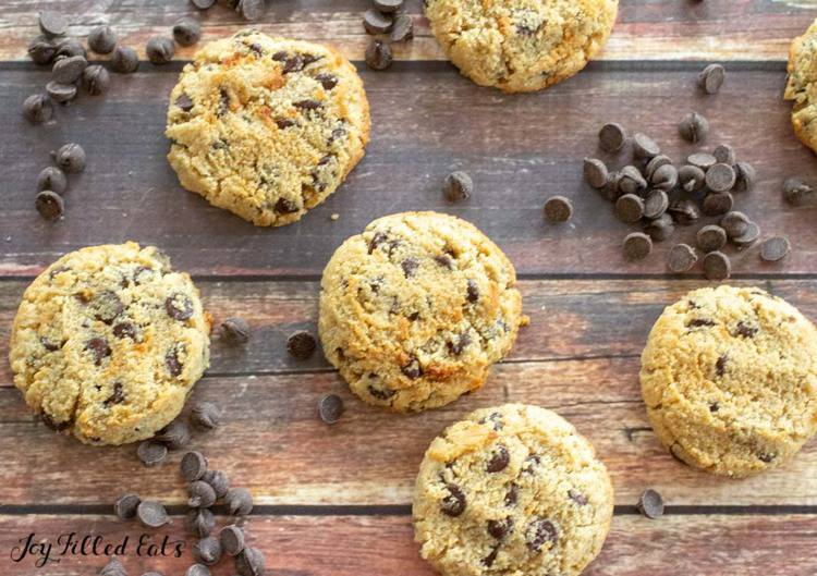 overhead shot of eggless chocolate chip cookies on a wood backdrop