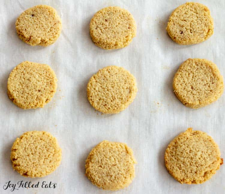 baked ginger molasses cookies on parchment paper