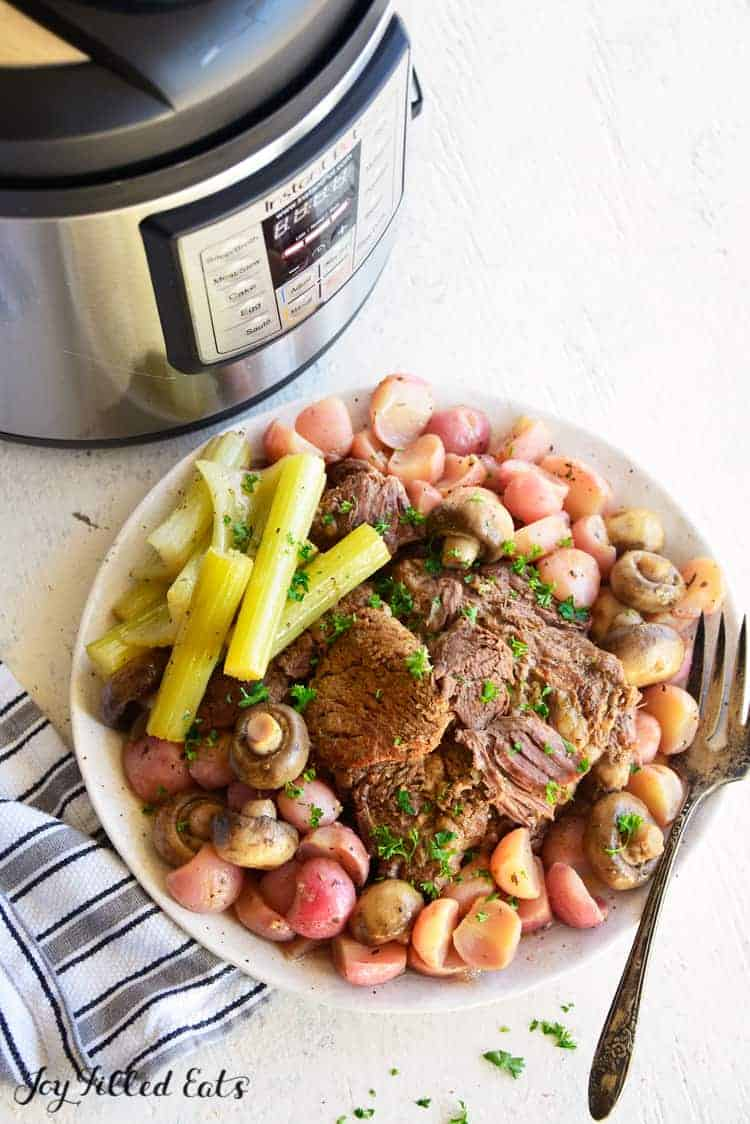 instant pot and pot roast recipe prepared and in the serving bowl