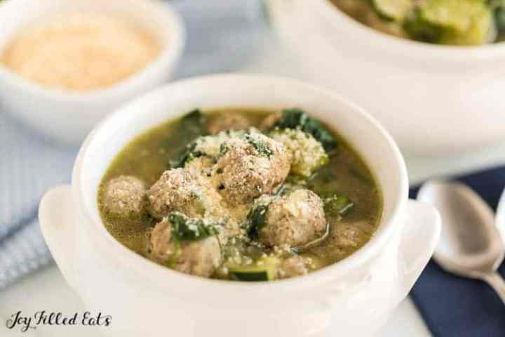 Italian Wedding Soup Recipe in a white crock with a spoon
