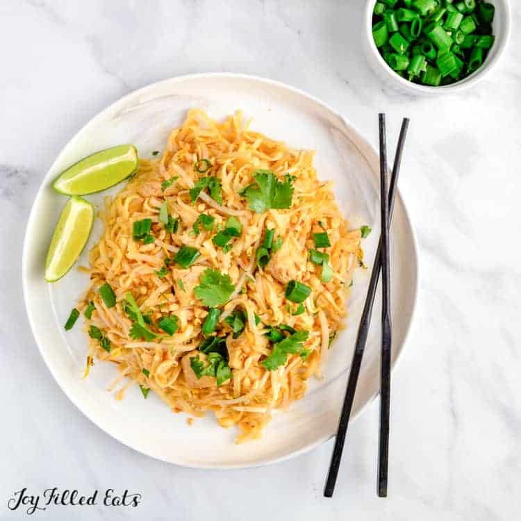 overhead shot of a plate of keto chicken pad thai with chopsticks