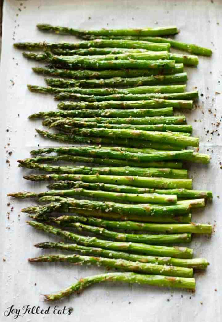 Roasted Asparagus out of the oven on parchment paper
