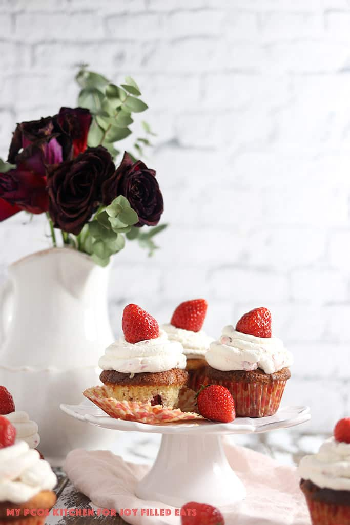 Sour cream vanilla low carb cupcakes made with strawberries on a cake plate