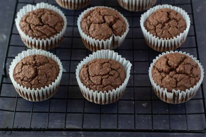 baked keto low carb chocolate cupcakes cooling on a wire rack