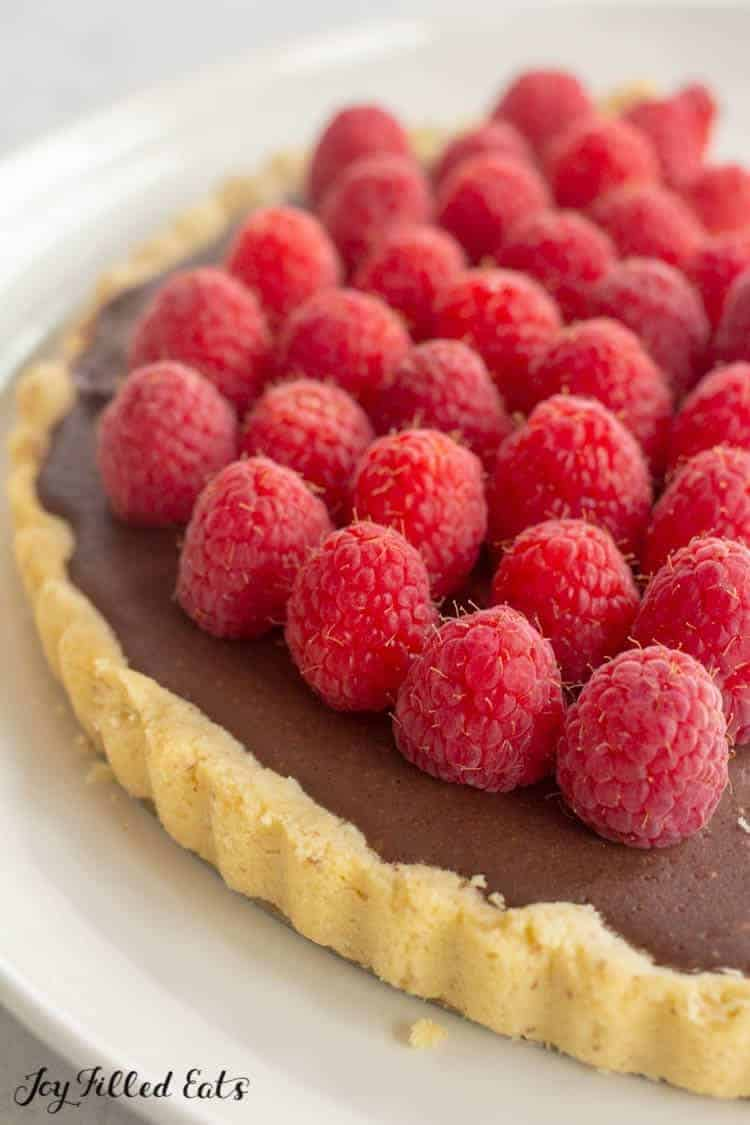 close up of the chocolate tart with raspberries