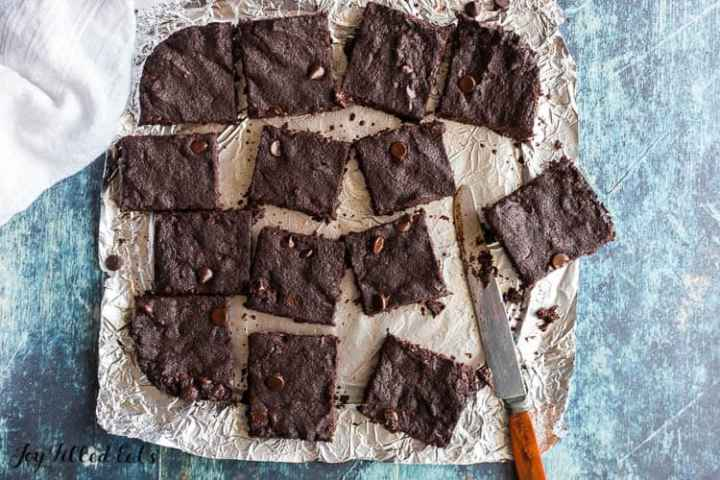 the cut brownies separated on the parchment lined foil