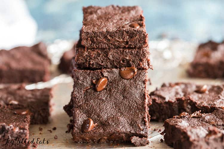 stack of flourless brownies with one leaning on it
