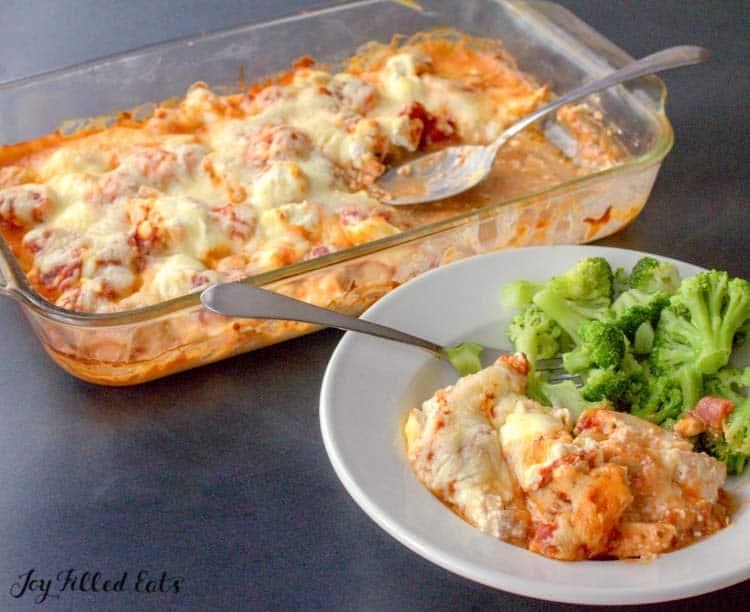 keto pizza casserole on a plate with broccoli