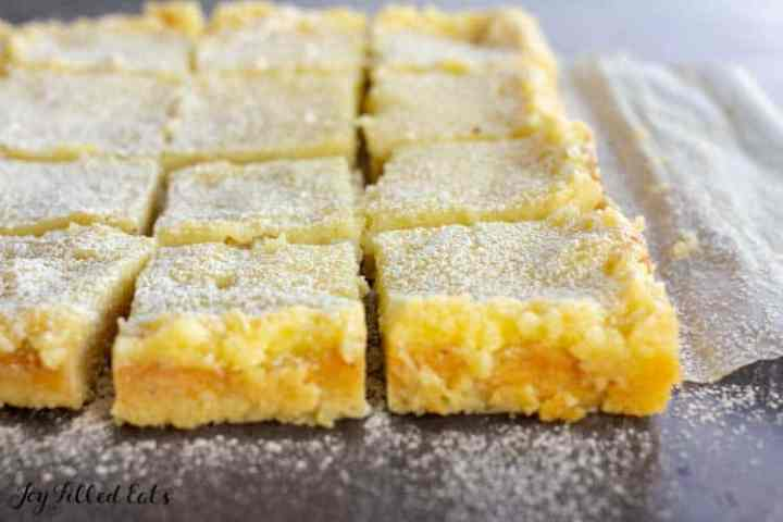 cut lemon squares on a piece of parchment